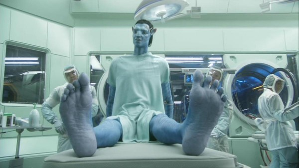 Jake (Sam Worthington) admires his new avatar body and the ability to once again wiggle his toes.