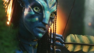 Separated from her fellow Na'vi during the battle, Neytiri (Zoe Saldana) readies her bow just before a major interruption comes her way.