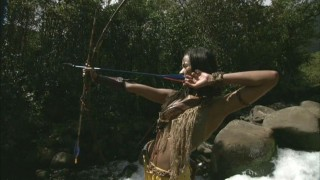 Zoe Saldana practices her archery during a performance-enhancing forest expedition.