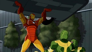 Iron Man, presently the most famous Avenger, lifts a car while defending the United Nations against HYDRA agents.