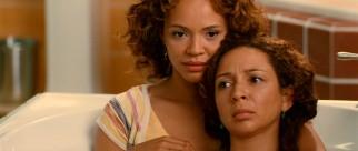 Verona (Maya Rudolph) spends some close, comforting time with her younger sister Grace (Carmen Ejogo) in a bathtub showroom.