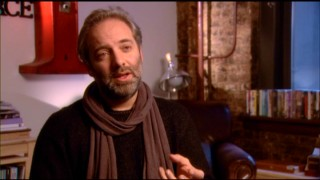 "With a scarf around his neck, Sam Mendes reveals his origins as a British stage director in ""The Making of 'Away We Go'."""
