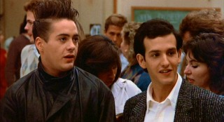 Robert Downey Jr. (left) shows off many a strange hairstyle and look as Jason's anti-establishment roommate.