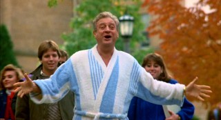 This fall, The Big Man on Campus wears a blue and white bathrobe while looking happy to see his son.