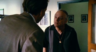 Looking like Chris Kattan aged for an old SNL character, Brad Dourif plays Ned Schoenholtz, Terence's put-upon bookie.