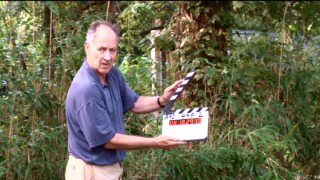 "Although he's directed such films as ""Aguirre, the Wrath of God"" and ""Grizzly Man"", director Werner Herzog isn't above holding the slate on a plantation scene shoot, as seen in the DVD's making-of documentary."