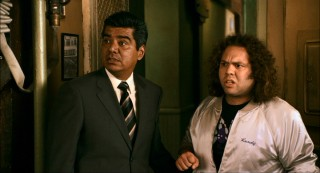 Agent Rodriguez (George Lopez) and Randy are slightly flabbergasted by what they see in Master Wong's Happy Mu Shu Palace.