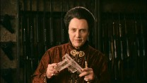 Feng (Christopher Walken) shows off an innovative polymer gun in this short deleted scene.