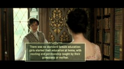 Tom (James McAvoy) teases Jane's naiveté as the trivia track informs us of female education, or lack thereof.