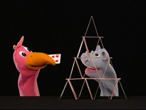 Large Bird tries to help Rhino with his house of cards in a bonus Puppet Show.
