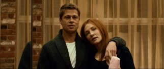 Meeting in the middle, Benjamin (Brad Pitt) and Daisy (Cate Blanchett) look at themselves in a mirror at her dance studio.