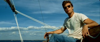 Reaching his physical peak in the 1960s, Benjamin cuts a Steve McQueen-type appearance on this sunny boat ride.