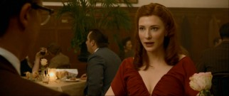 On his audio commentary, David Fincher professes a distaste for using the color red, but he can't resist giving Daisy (Cate Blanchett) a dress to match her vibrant hair in this 1940s dinner scene.