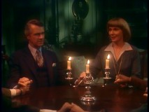 "The Governor, Miss Kraus, and the rest of the staff join hands for a seance in ""Ghost Story."""