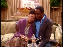 Benson embraces his ex-girlfriend (Denise Nicholas), while raising suspicions of an affair.