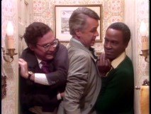 Taylor, the Governor, and Benson squeeze into a tight bathroom because it's the only place in the house that's not been bugged.