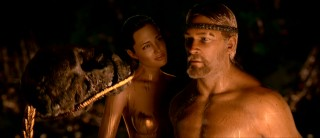 Grendel's Mother (Angelina Jolie) tries to seduce Beowulf (who only looks like Sean Bean).