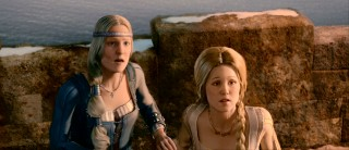 Beowulf's aged wife and young mistress (Alison Lohman) unite in shocked reaction to the sight of a fiery dragon.