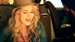 "In the bonus music video, Bridgit Mendler sings part of ""This Is My Paradise"" parked in a van at the beach."