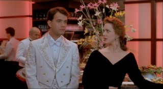 Hard-working executive Susan Lawrence (Elizabeth Perkins) takes an interest in the unique Josh, here at a company party.