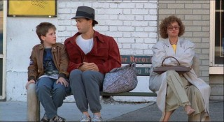 Billy and Josh are joined by a woman on the bus stop bench in this alternate version of an existing scene.