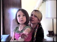 Frankie (Faith Wladyka) and the Unicorn (Michelle Williams) have fun in an unused home movie born out of the three cast members' month of playing family.