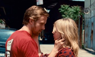 Dean (Ryan Gosling) and Cindy (Michelle Williams) share a sidewalk kiss in their younger, happier days.