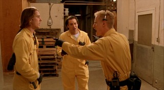 Dignan encourages sticking to the plan as, clad in conspicuous yellow jumpsuits, our three leads try to pull off a big heist of a cold storage facility.