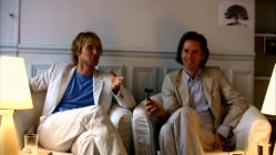 Co-writers Owen Wilson and Wes Anderson reflect on their first collaboration in the DVD's commentary and making-of documentary. Here in the latter, Wes holds up a low-tech two-way microphone for them.
