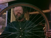 "Staten Island shopkeeper Murray Braverman inspects a bicycle wheel in ""Murita Cycles."""