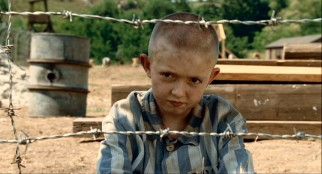 "Meet Shmuel (Jack Scanlon), the eponymous boy in the ""striped pajamas"" who lives and works on the other side of the barbed fence."