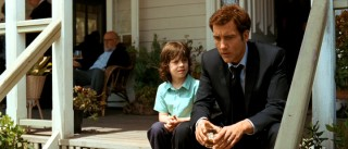At his mother's funereal gathering, young Artie (Nicholas McAnulty) discusses death with his widowed father (Clive Owen).