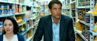 Joe (Clive Owen) maintains contact with his dead wife Katy (Laura Fraser), who advises him in visions like this grocery store one.