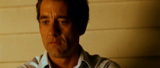 Joe Warr (Clive Owen) steps outside to make his sad dad face in solitude.