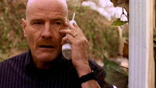 Chemistry teacher Walter H. White (Bryan Cranston) takes the cordless home phone outside to deal with one of several concerns growing out of his secret second life as a big-time manufacturer of methamphetamine.