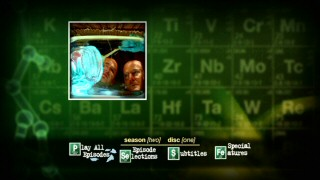 Walt and Aaron coat a baking pan with blue gel amidst the green chemical imagery of the Disc 1 main menu (and show opening title screen).