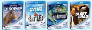 "A look at the preliminary packaging design for Disney's first four Blu-ray disc releases, due September and October 2006: (left to right) ""Dinosaur"", ""Eight Below"", ""The Haunted Mansion"", and ""Glory Road."""