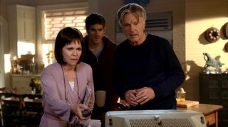 There are two ways to identify this as a flashback: Nora's clearly turn-of-the-decade choppy short bangs and the sight of a living William Walker (Tom Skerritt). Here, Nora, Justin, and William are shocked at news of the September 11th attack on the Twin Towers.