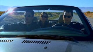 Tommy, Sarah, and Kevin don sunglasses for their road trip to look at the Nevada land their father bought.