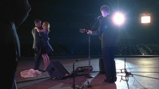 "Kitty (Calista Flockhart) and Robert (Rob Lowe) experience ""Something New"" as Lyle Lovett performs a song for only them."
