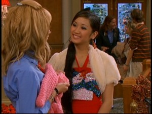 "London (Brenda Song) tries to spread Christmas cheer by hand-knitting a sweater for Maddie (Ashley Tisdale) in the episode found on the ""Disney Channel Holiday"" DVD."