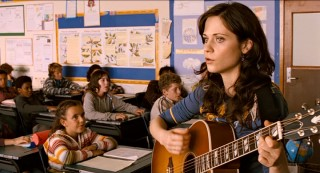 Either Jess's school has music class more than once a week or his feelings towards pretty music teacher Ms. Edmonds (Zooey Deschanel) merit more screen time.