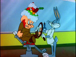 "Elmer Fudd is anything but pleased with the fruit arrangement his barber has given him in ""The Rabbit of Seville."""