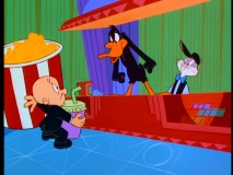 "Daffy Duck tries to illuminate movie theater usher Elmer Fudd to Bugs Bunny's diversions in 1990's ""Box-Office Bunny"", one of three new-to-DVD shorts."