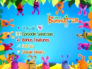 Colorful bunnies form a border around the main menu.