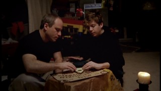 Documentary filmmaker and awkward teen share a Ouija board moment.
