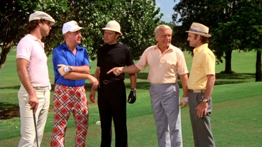 Caddymaster Lou Loomis (co-writer Brian Doyle-Murray, far right) officiates the film's big climactic game, which pits Ty (Chevy Chase) and Al (Rodney Dangerfield) against Dr. Beeper (Dan Resin) and Judge Smails (Ted Knight).