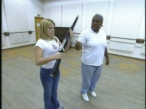 "Hilary Duff learns how to spin a rifle in the brief featurette ""Learning the Drills."""