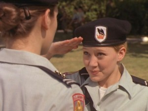 Cadet Kelly sarcastically salutes her unfriendly superior.