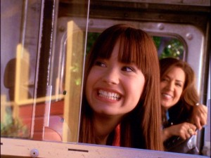 Upon seeing Camp Rock for the first time, Mitchie (Demi Lovato) flashes her trademark toothy grin alongside her caterer mother (Maria Canals Barrera).